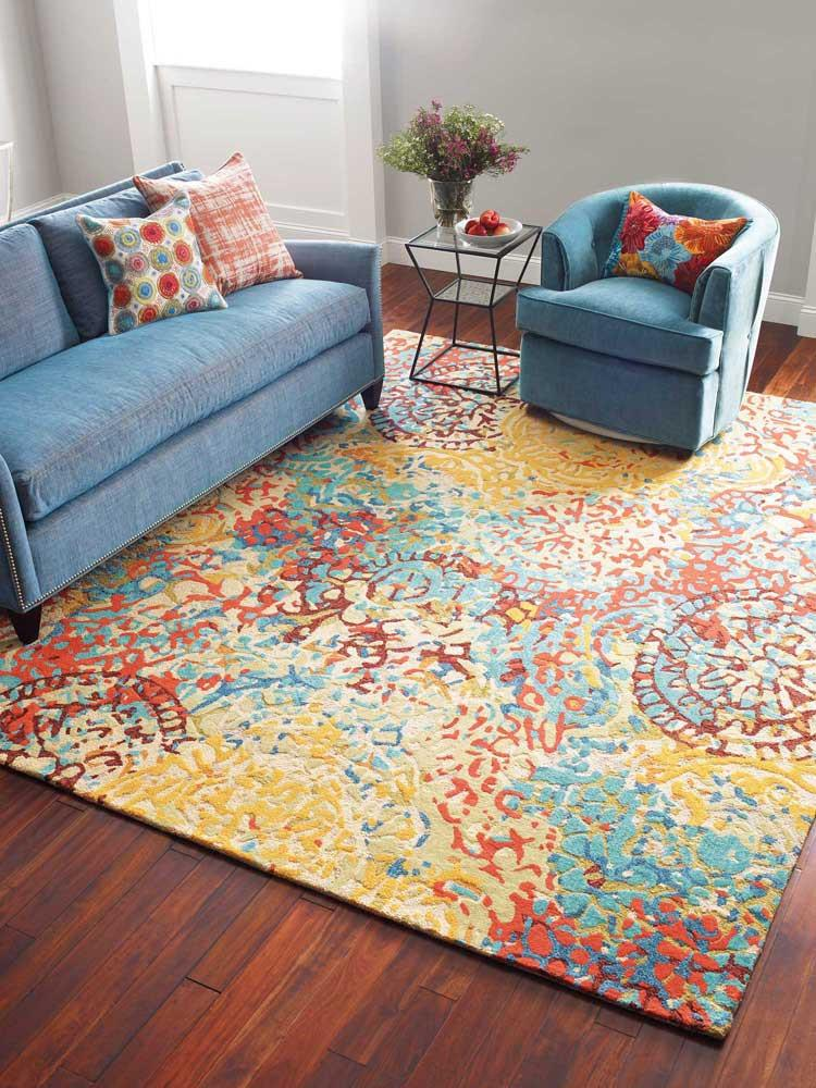Our Melange Hand Tufted Area Rug Features An Abstract Over