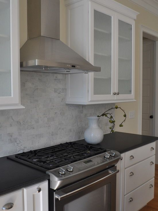 frosted glass cabinets, dark counter, white cabinets, carrera ...