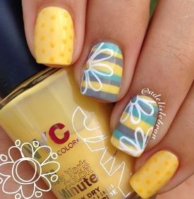 Yellow nails. Polka-dots and stripes. White flower. Cute.