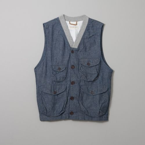 cb944372b2d Universal Works Angler Waistcoat made with 100% cotton chambray and  finished with 100% cotton rib.  145