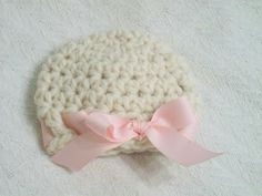 Free Crochet Pattern: My Super Bulky Newborn Hat - Girlie Version...these work up very quickly using super bulky yarn and an N (10mm) hook. I love the ribbon in it!