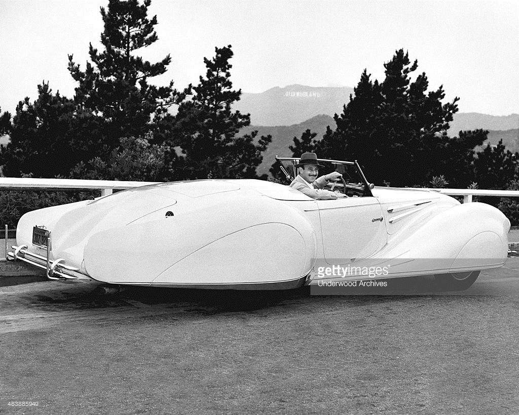A man in a 1949 Delahaye coupe, Los Angeles, California, 1949.