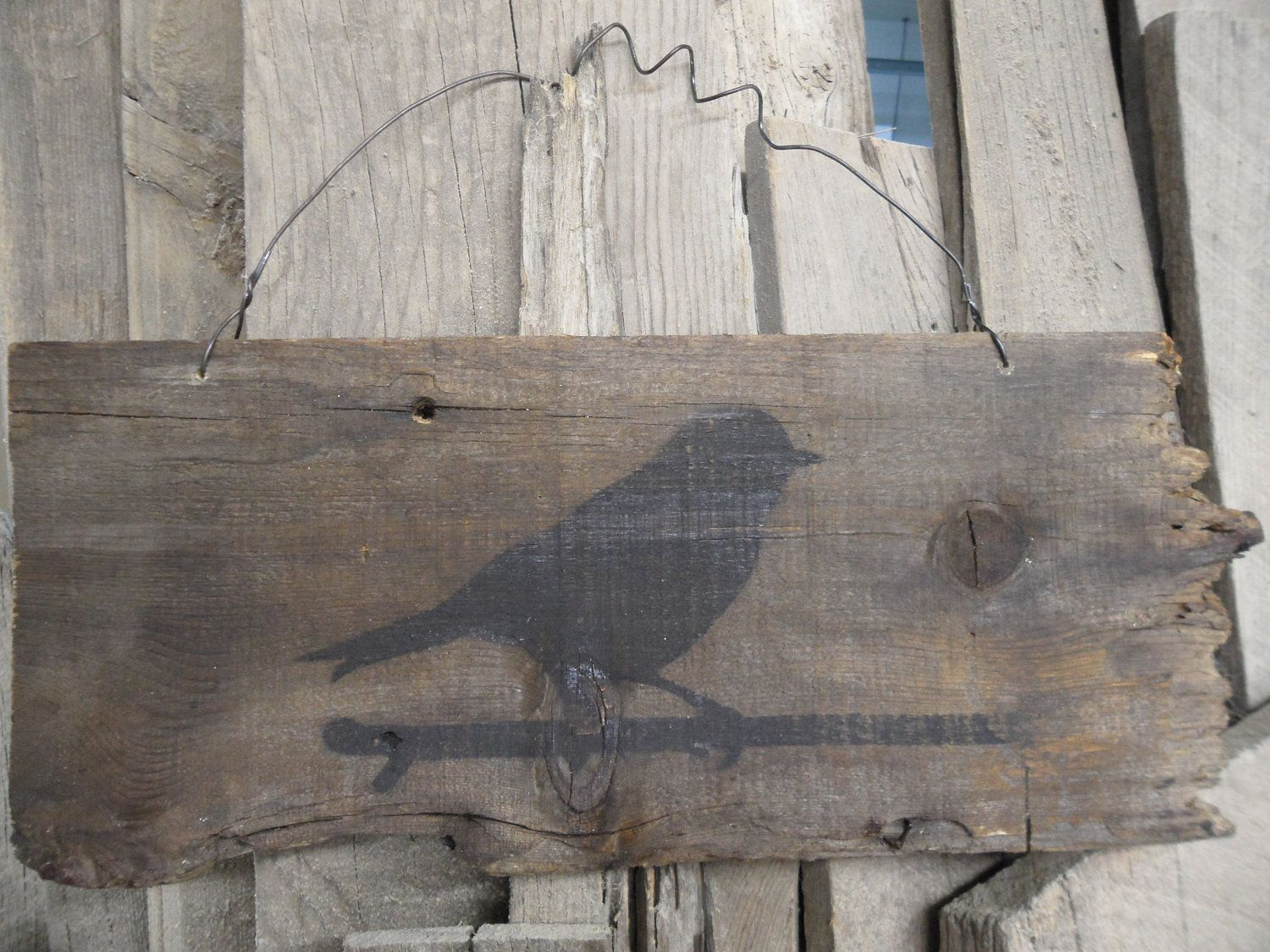Bird on a wire stencil on a piece of old barnwood with baling wire ...