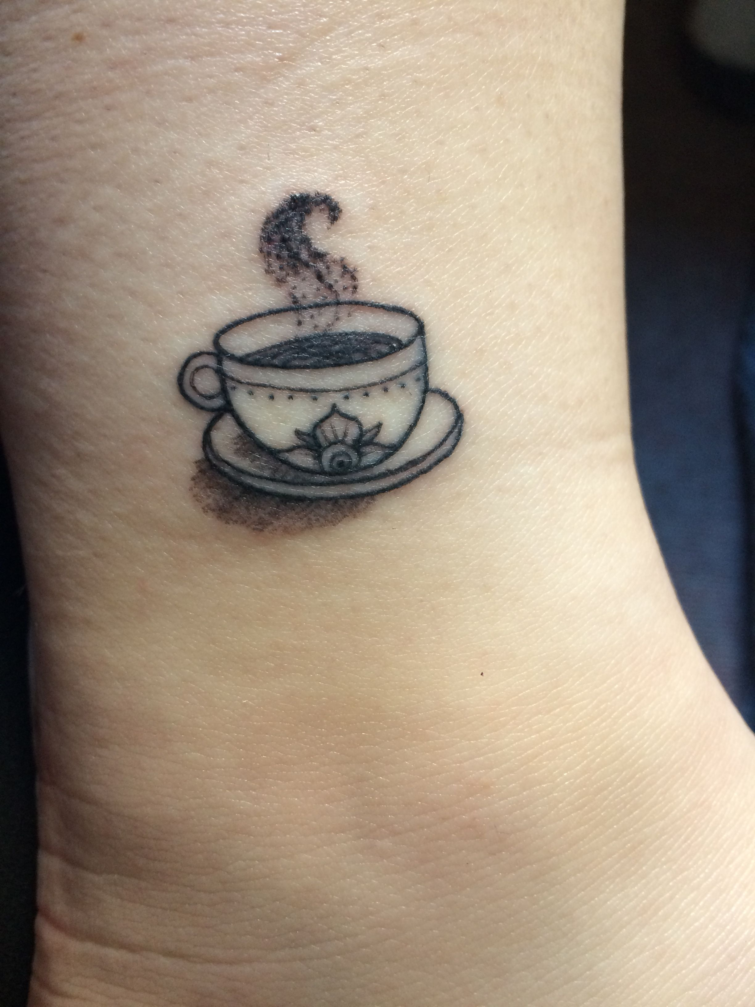 small coffee cup tattoo done by jimmy at electric soul