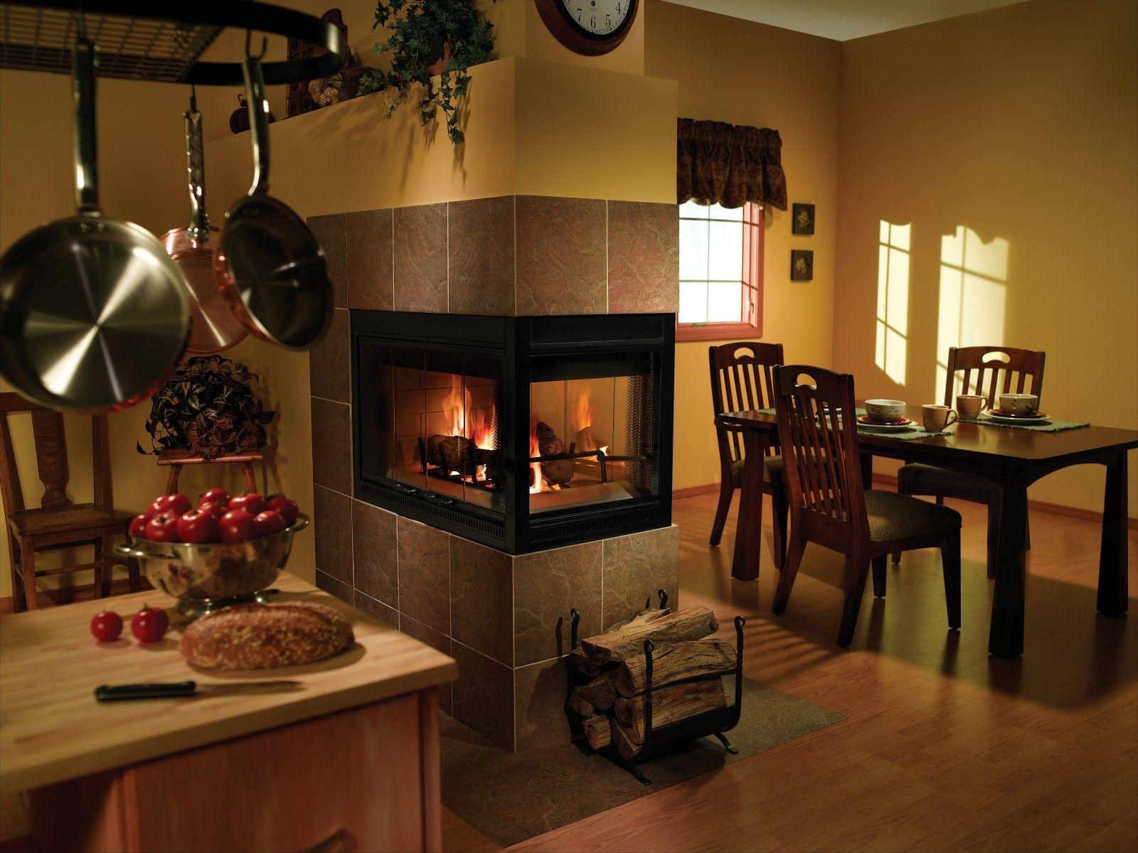 Interior. Fashionable Wood Burning Fireplace Insert On Corner Ceramics Tile Set In Open Kitchen