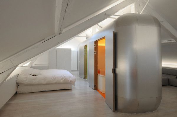 the refurbished industrial kempart loft gets a drastic makeover by dethier architectures complete with a modular aluminum pod that not only breaks the
