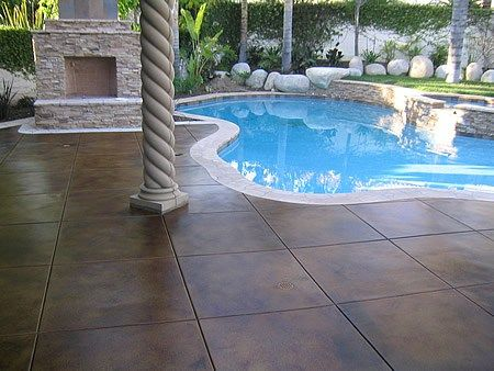Dark Brown Stained Deck Concrete Pool Decks Infinity Concrete