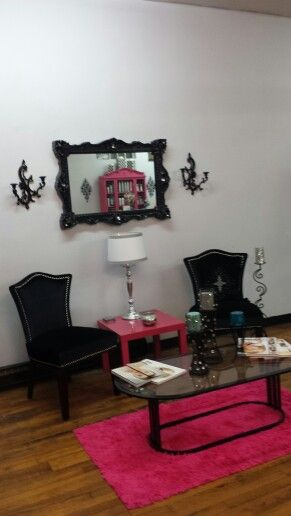 6bb956425587 Glam pink and black hair salon seating area