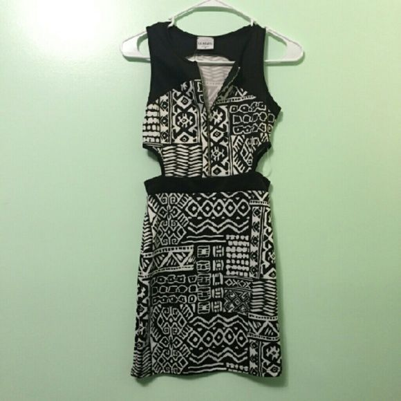 LA Hearts Mini Dress Black and white tribal dress. Cut out on the sides with a very stretchy material. Has a zipper in the front of the cleavage. LA Hearts Dresses Mini