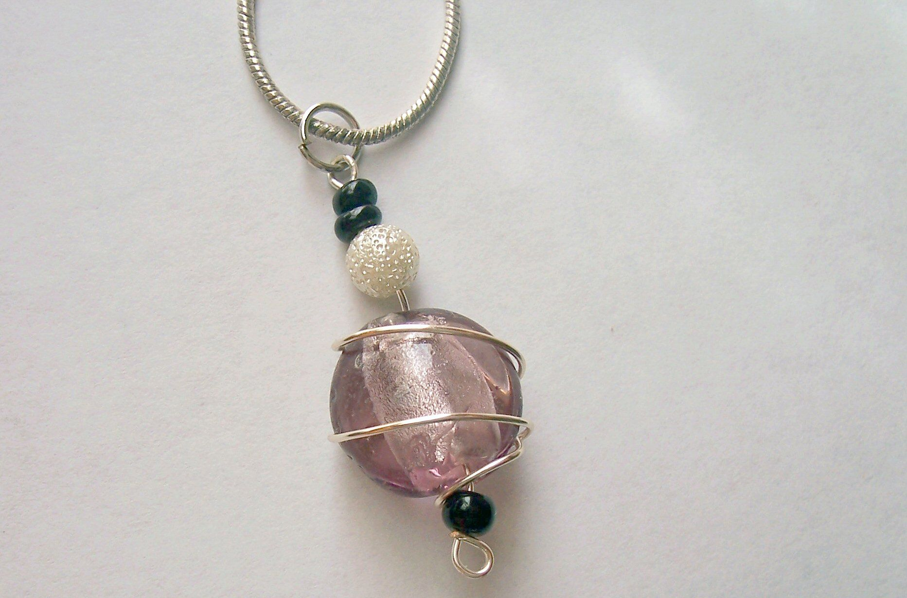 Wire wrapped necklace I made last week. There are matching earrings ...