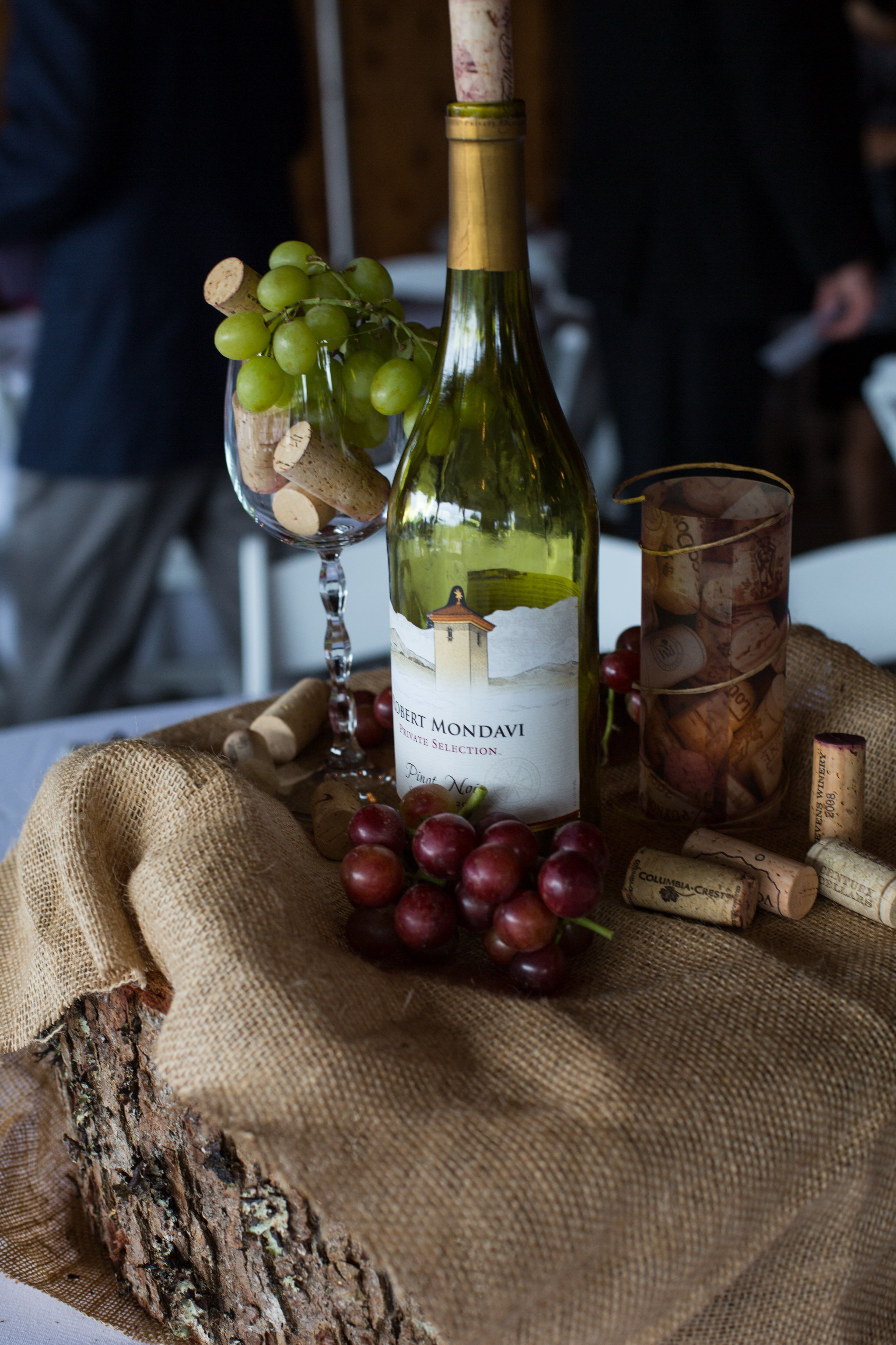 53 vineyard wedding centerpieces to get inspired diy candle wedding centerpieces for wine themed wedding at rustic farm wine glass filled with real grapes and corks wine bottle with cork tealight candle inside diy junglespirit Image collections