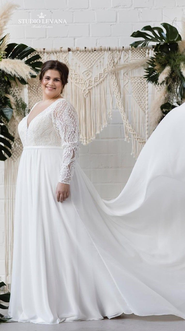 Bohemian plus size wedding gown with vintage lace and long