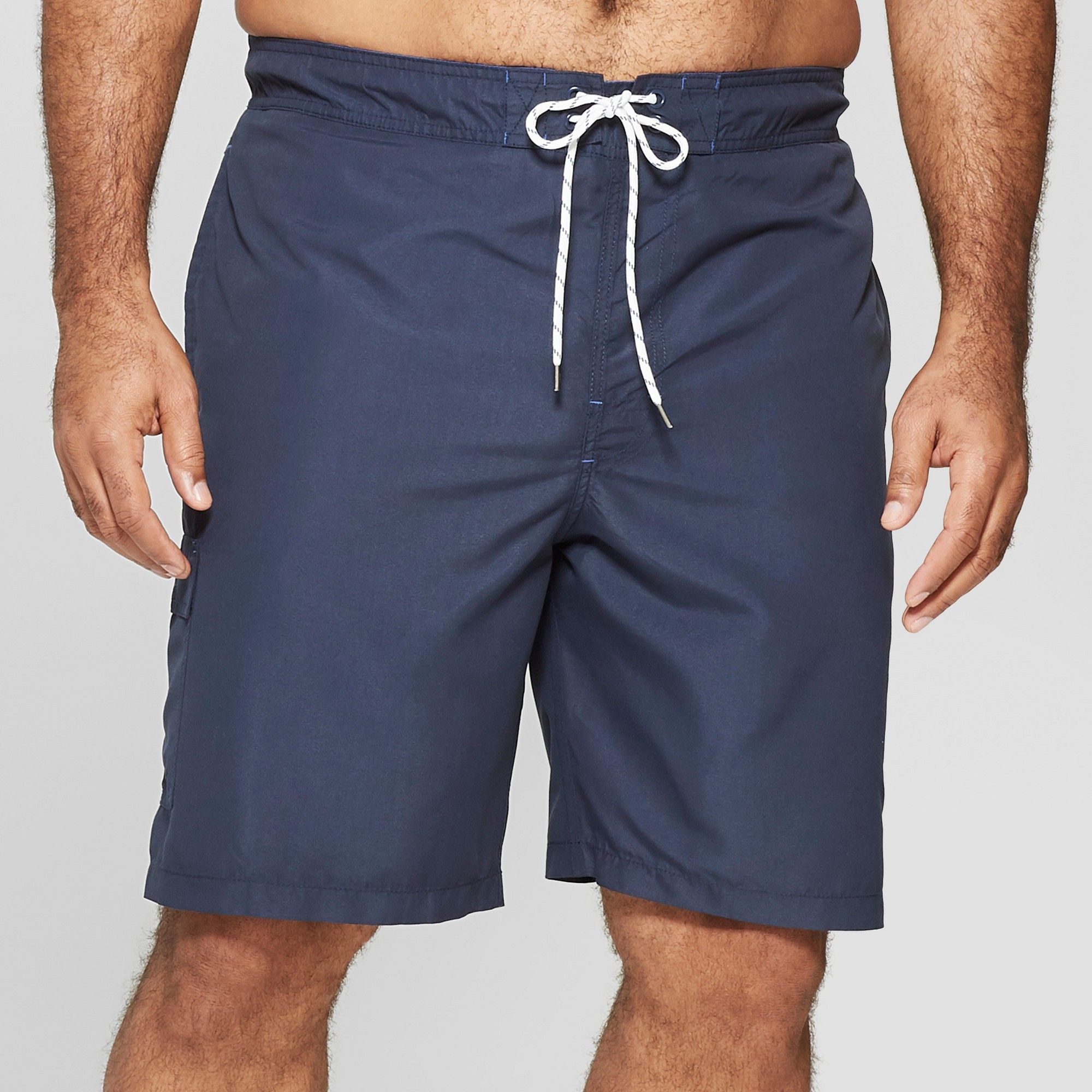 b9ed37a904 Add a touch of classic style to your swim look with these men's Taped Board  Shorts from Goodfellow and Co. Featuring a solid-color design w…