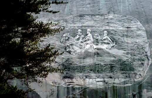 Figures of Stonewall Jackson, Robert E. Lee and Jefferson Davis are carved into the bas-relief of Stone Mountain.