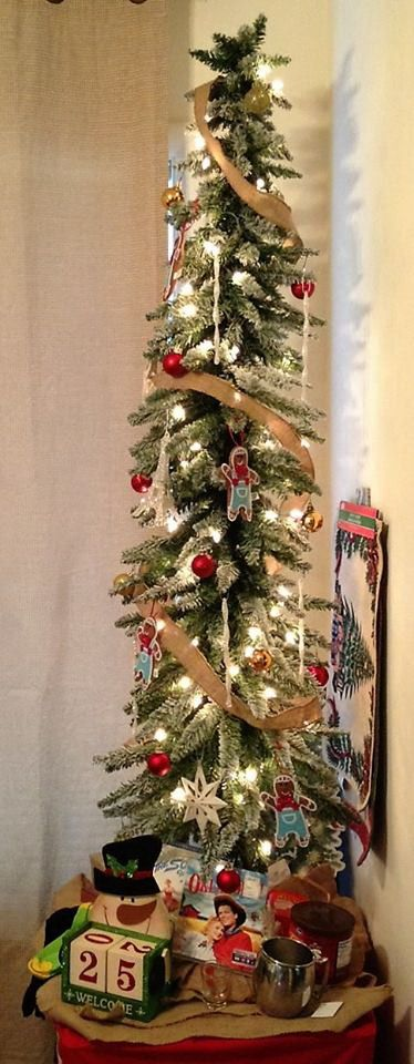5' Flocked Slim Christmas Tree from Hobby Lobby with a Burlap ribbon, tree  skirt and some Gingerbread men ornaments. Set up in the corner of the room  on a ... - 5' Flocked Slim Christmas Tree From Hobby Lobby With A Burlap Ribbon