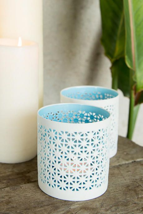 "This gorgeous set of ceramic candle holders will add a colorful touch to any room in your home or apartment! The blue hue pops against the white ceramic. Pair with our additional home decor options to complete your room.<br /> <br /> - Includes 2 holders<br /> - Materials: ceramic<br /> - Each measures 3"" x 3.25""<br /> - Tea lights not included<br /> - Imported"