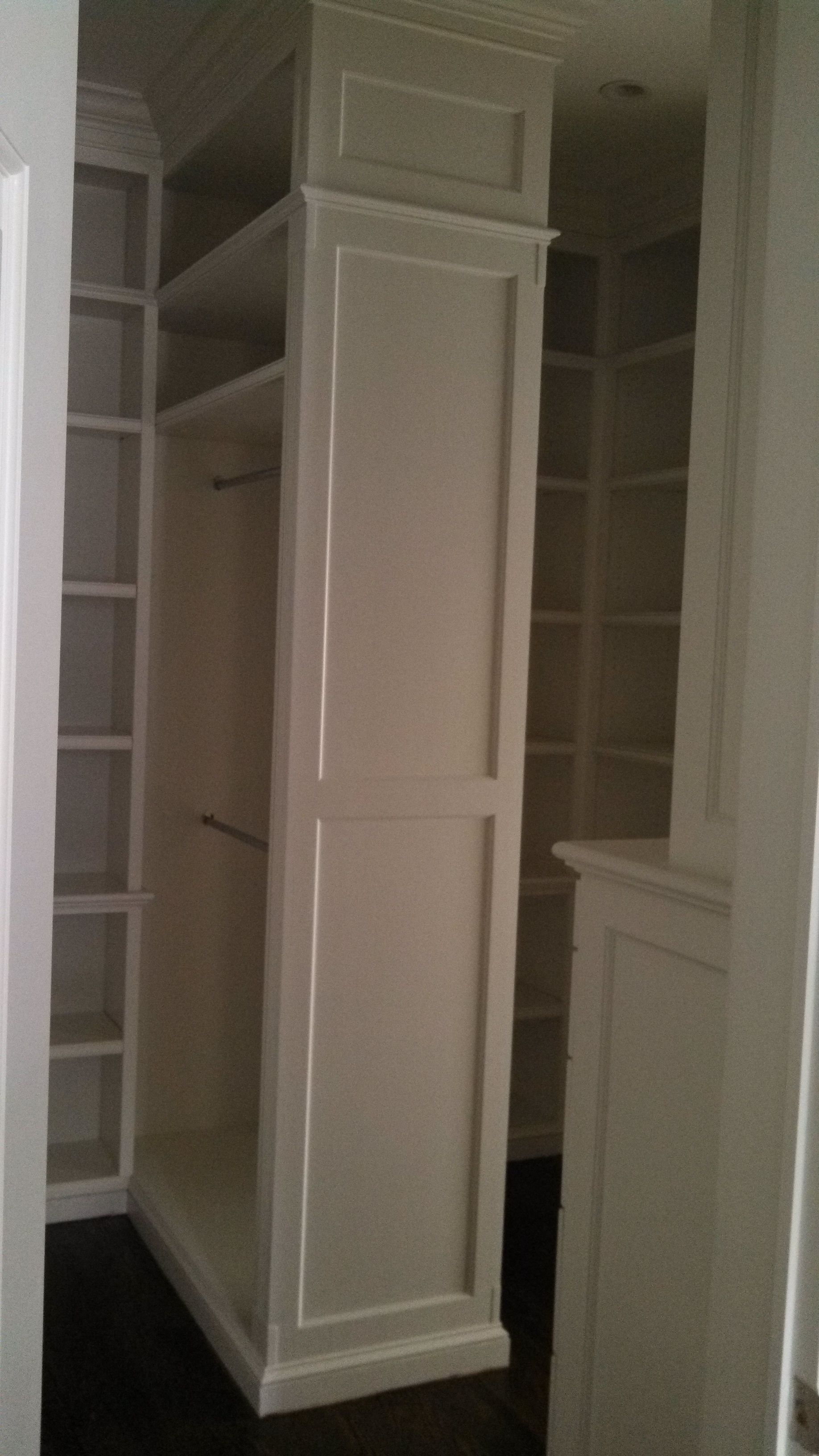 Luxurious Walk In Closet By Virginia Cabinetry