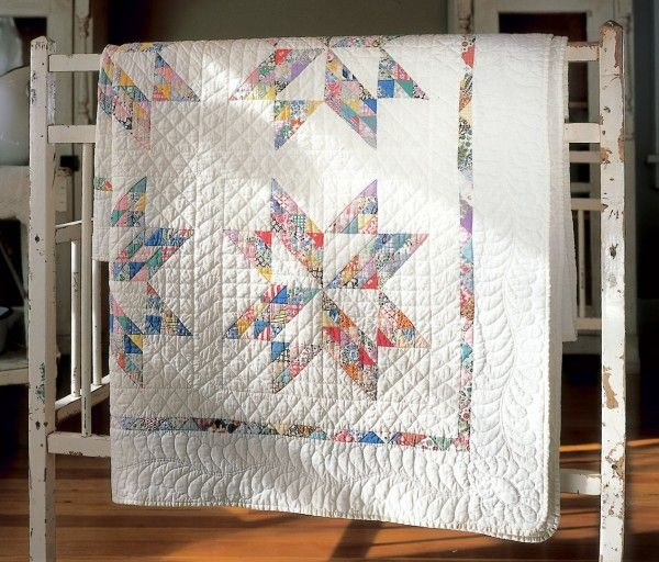 """TWINKLING STAR Free classic quilt pattern:  Use up lots of fabric scraps making this vintage quilt pattern. Finished size is 66"""" x 100"""", great for an extra-long twin size bed or for family sofa snuggling!"""