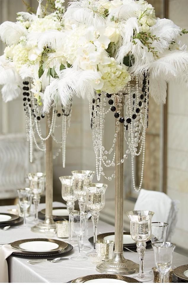 Draped Garlands Of Pearls And Gems Give These Centerpieces A Chandelier Effect Great Gatsby Wedding