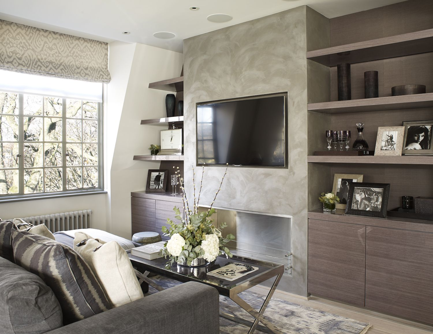 Tv feature wall in sitting area by the olive design studio - Feature wall living room ...