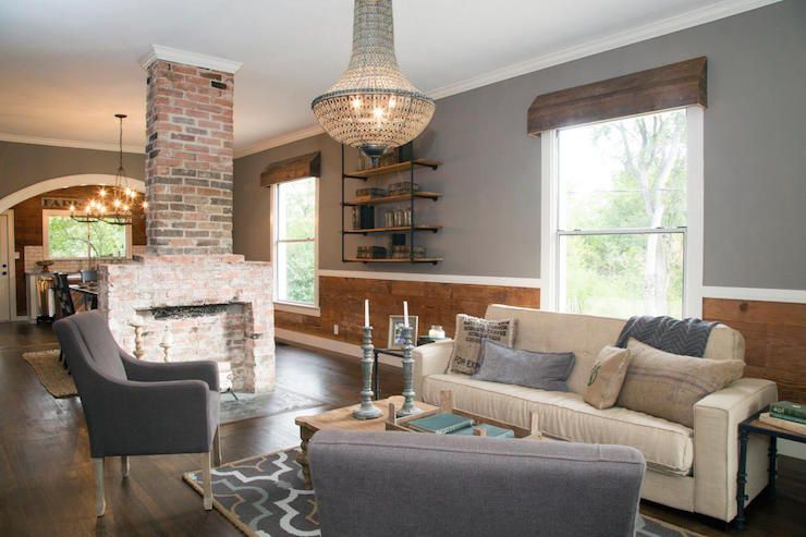 Fixer Upper Modern Country Living Room Features Gray Paint On Upper Walls And Barn Board