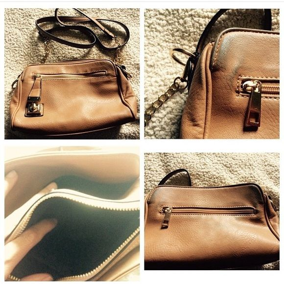 Tan cross body bag Tan faux leather cross body bag with gold hardware. This is a beautiful bag. Very good used condition. Slight color transfer on edges. H 6.5 in. x W 9.24 in. x D 2.75 in. Strap drop 25 in. removable. Bags Crossbody Bags
