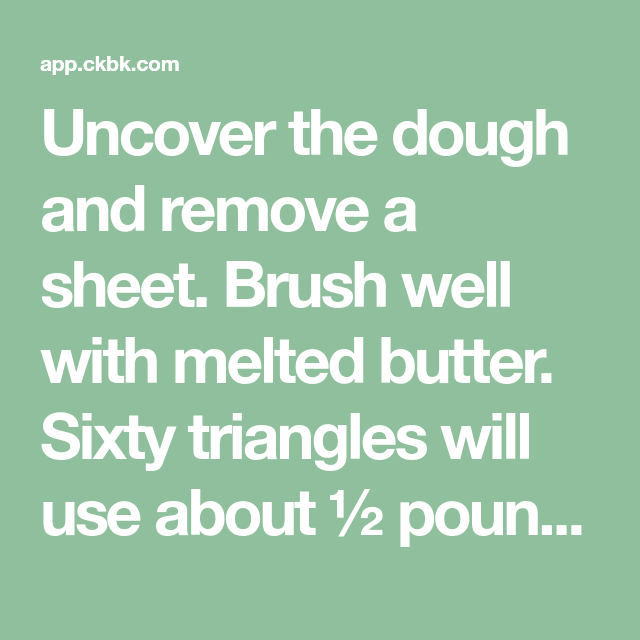 Uncover the dough and remove a sheet. Brush well with