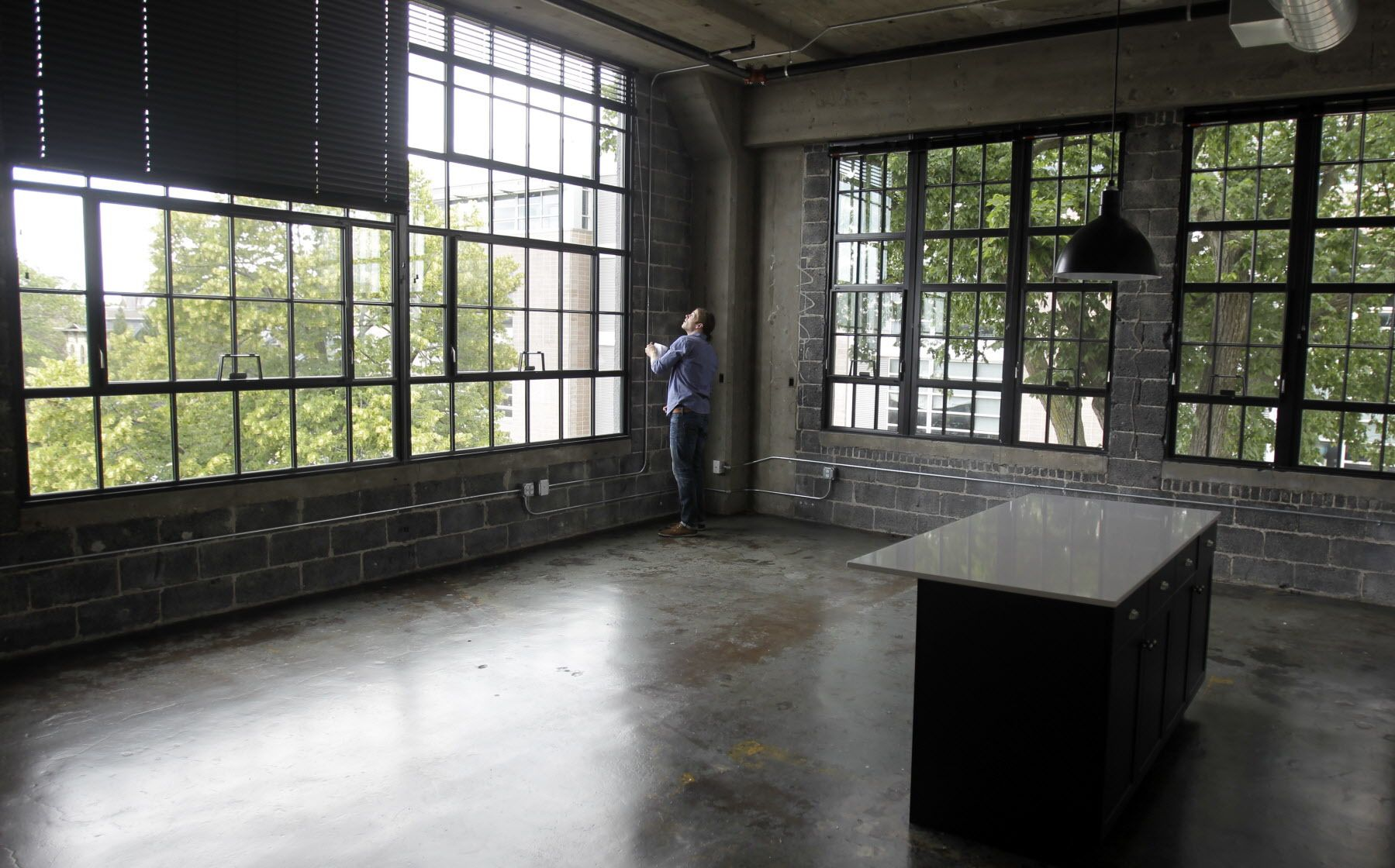 Developer Tyler Hawley Opens The Blinds In A Two Bedroom Apartment At The  Recently Opened