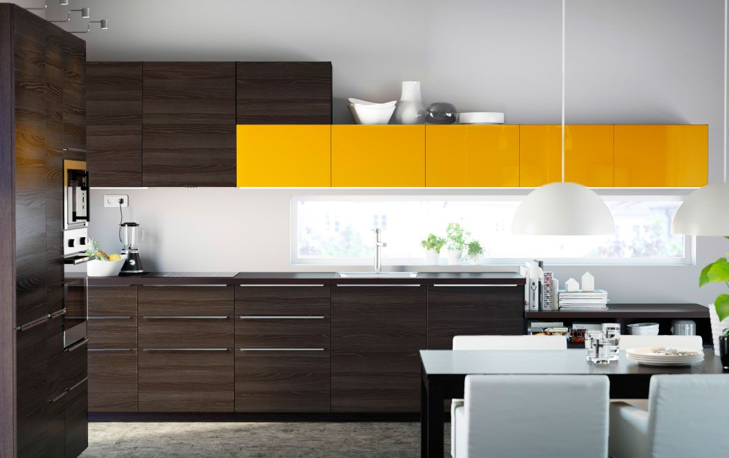 A modern dark kitchen with TINGSRYD black fronts and JÄRSTA yellow ...