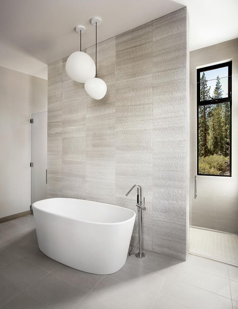 Bathroom inspiration - a freestanding bathtub with stone feature ...