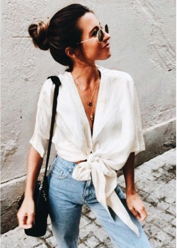 Pretty white blouse with blue jeans.