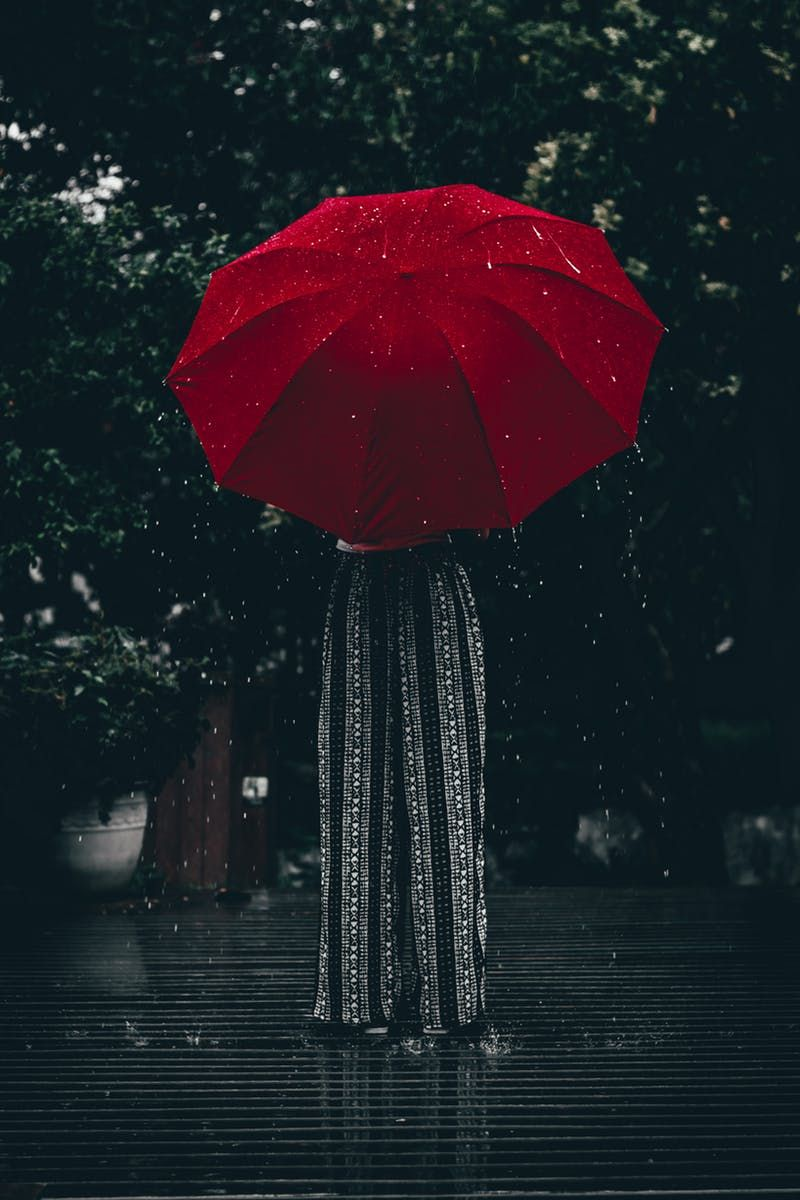 Person Standing Using Red Umbrella · Free Stock Photo