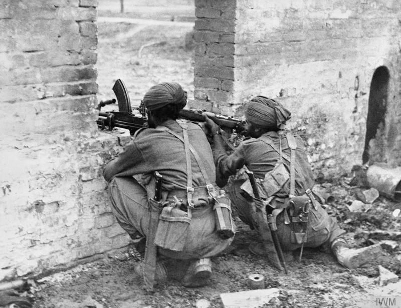 Sikh troops of 19th Indian Division in action at Fort Dufferin in Mandalay, Burma, 9-10 March 1945.