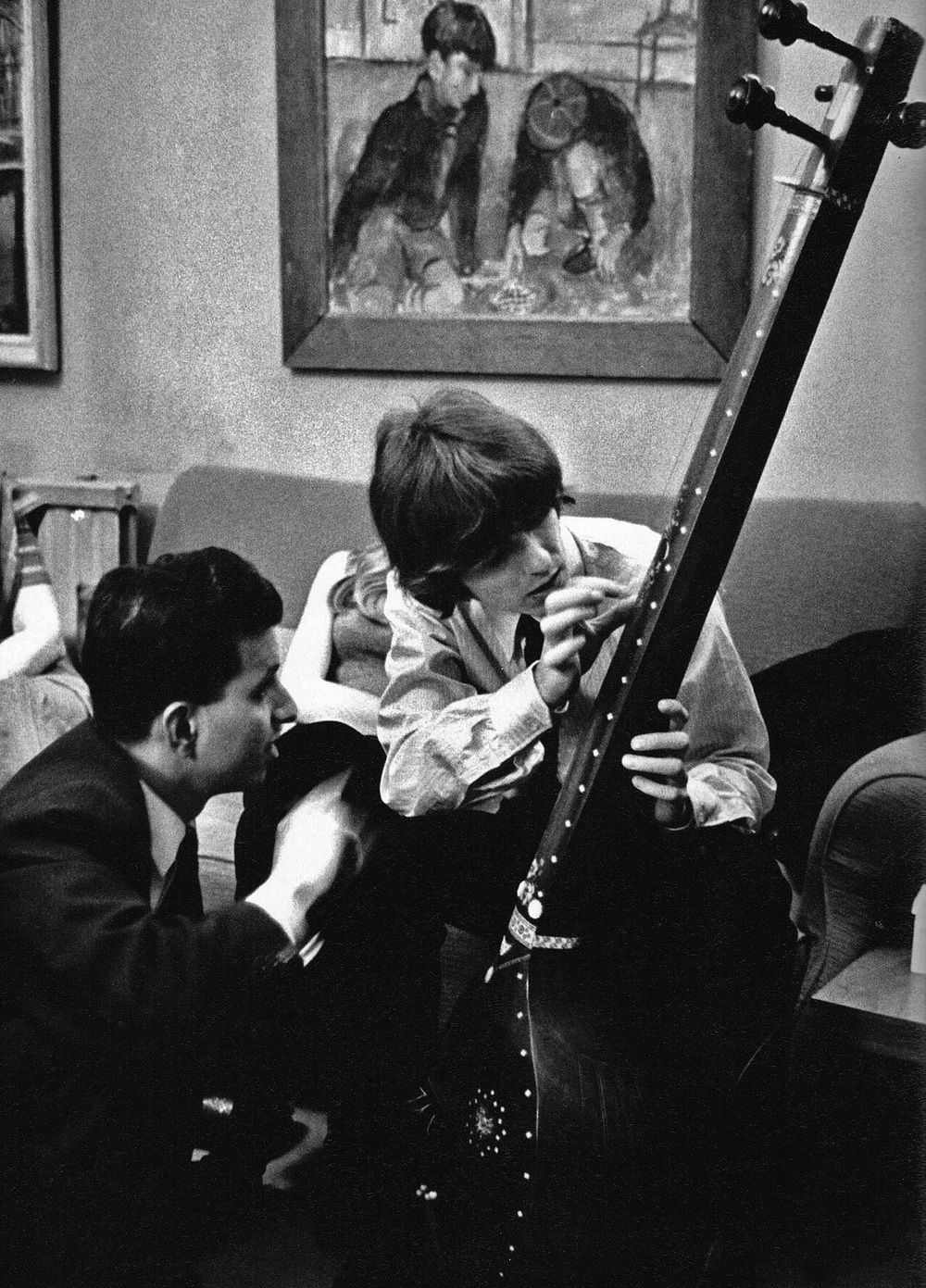 George Harrison inspecting a sitar, 1965. | The beatles, Beatles photos,  Beatles george