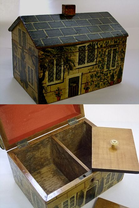 A rare GIII painted country house tea caddy with two dormer windows. Internally it has twin compartments with much of it's orignal foil lining. It retains its original paint work with slight wear to it in places, in keeping with it's age Circa 1800