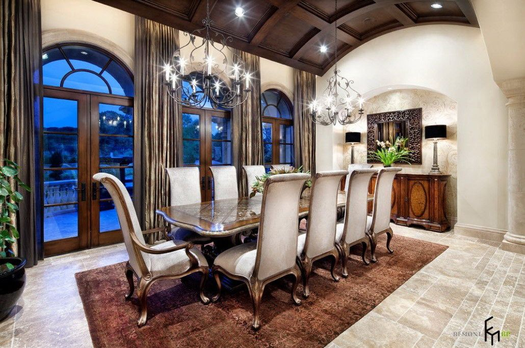 A Breathtaking Dining Room With Antique Wooden Chairs And Glamorous Gl Table Stunning Chandelier Brown Rug Also Astonishing Mirror Decor Chic