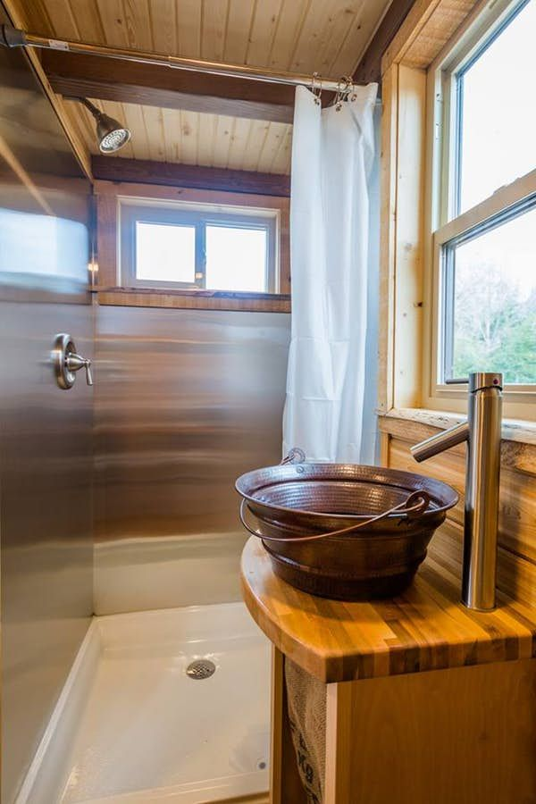 The Bathroom In Daviss 22 Ft Off Grid Tiny Home Includes A Shower Sink