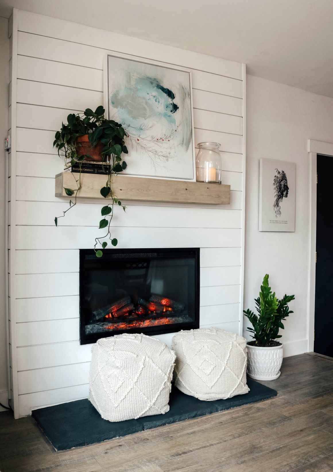 Dated Rock Fireplace turned Electric Shiplap Fireplace