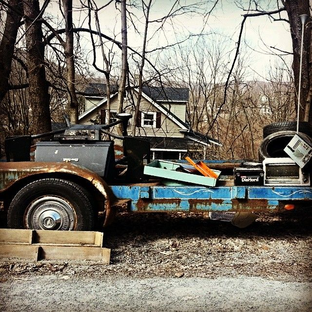 noironyintended Old trailer #trailer #rust #wheel #tire #tv #toasteroven #gasoline #lumber #trees #forest #mountains #Appalachia