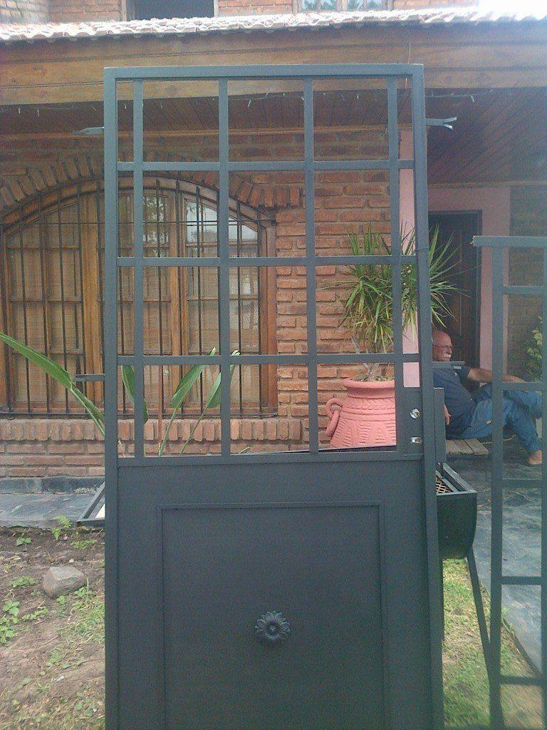 Puertas ventanas y mamparaspuertas de hierrode hierro for Puertas y ventanas de hierro antiguas