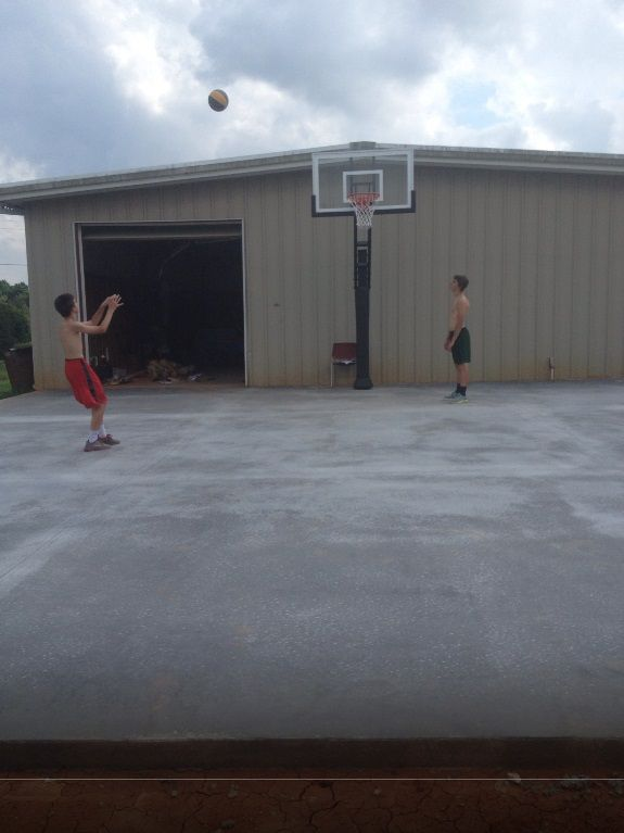 This is a great photo to get a sense of how large a 40' by 40' foot court really is. This pro dunk gold basketball system is a great addition to your home for lots of fun.