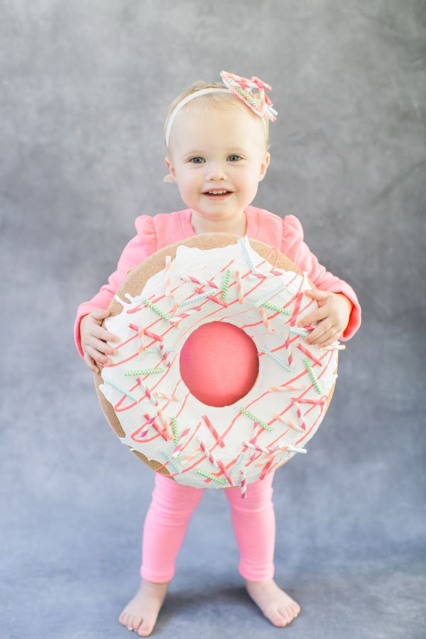 The cutest little donut you've ever seen! http://www.stylemepretty.com/living/2015/10/09/diy-halloween-costume-donut/ | Photography: Ruth Eileen - http://rutheileenphotography.com/