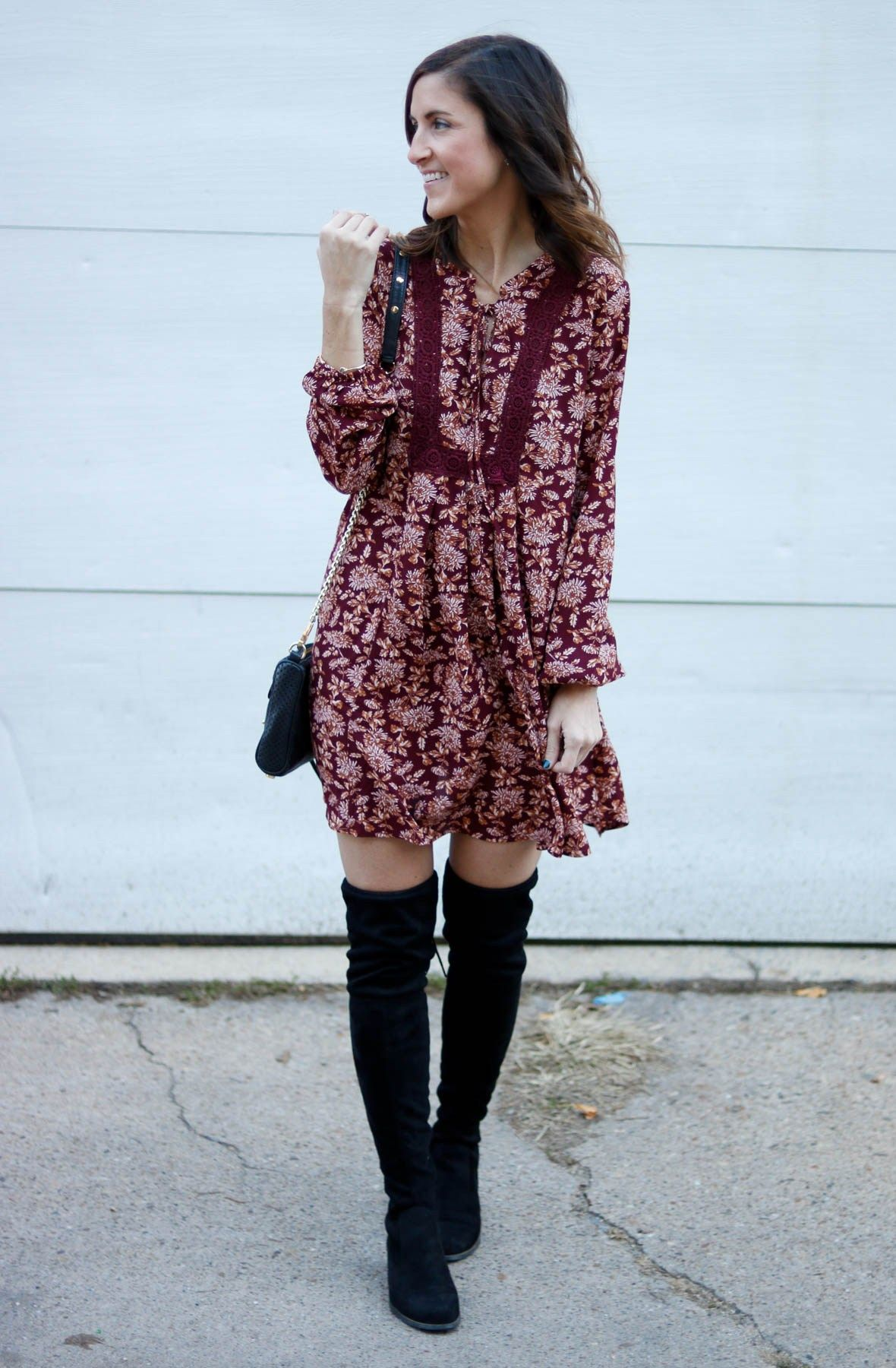Maroon dress paired with over the knee boots.