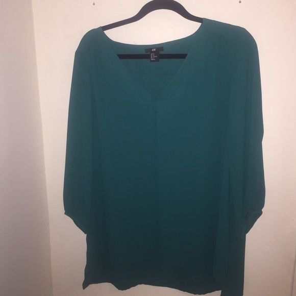 Teal H&M 3/4 length sleeve shirt Flowy deep teal v-neck shirt from H&M. Great condition and beautiful color. No trades please. H&M Tops Blouses