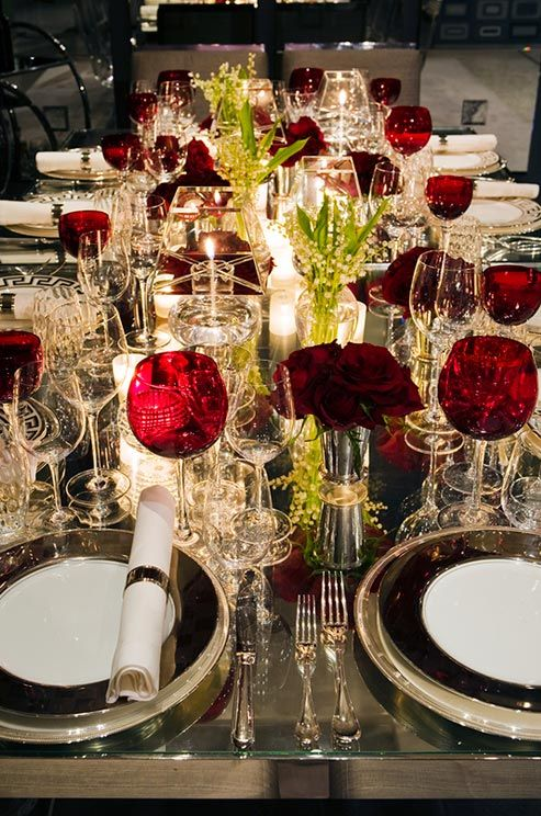 Layer silver, white, black and red for an elegant, sleek table.