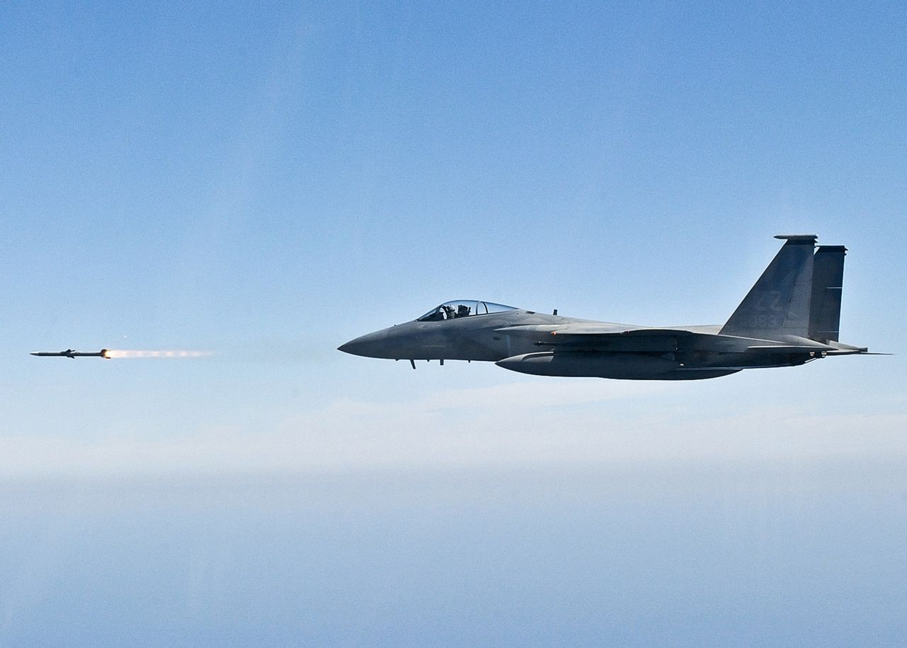 Military Aircraft — retrowar F15 Eagle fires an AIM120