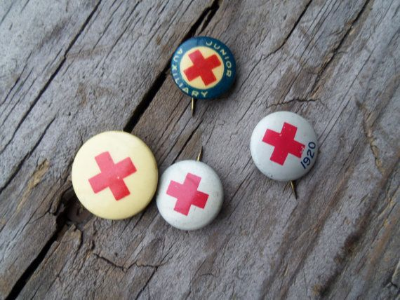 Vintage set of four red cross pins, pins have a vintage patina, otherwise very good vintage condition.  Largest one measures 3/4 in diameter, two