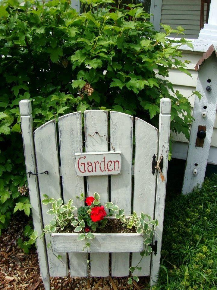 Garden Gate Planter W/Red Geranium & leafy vine foilage