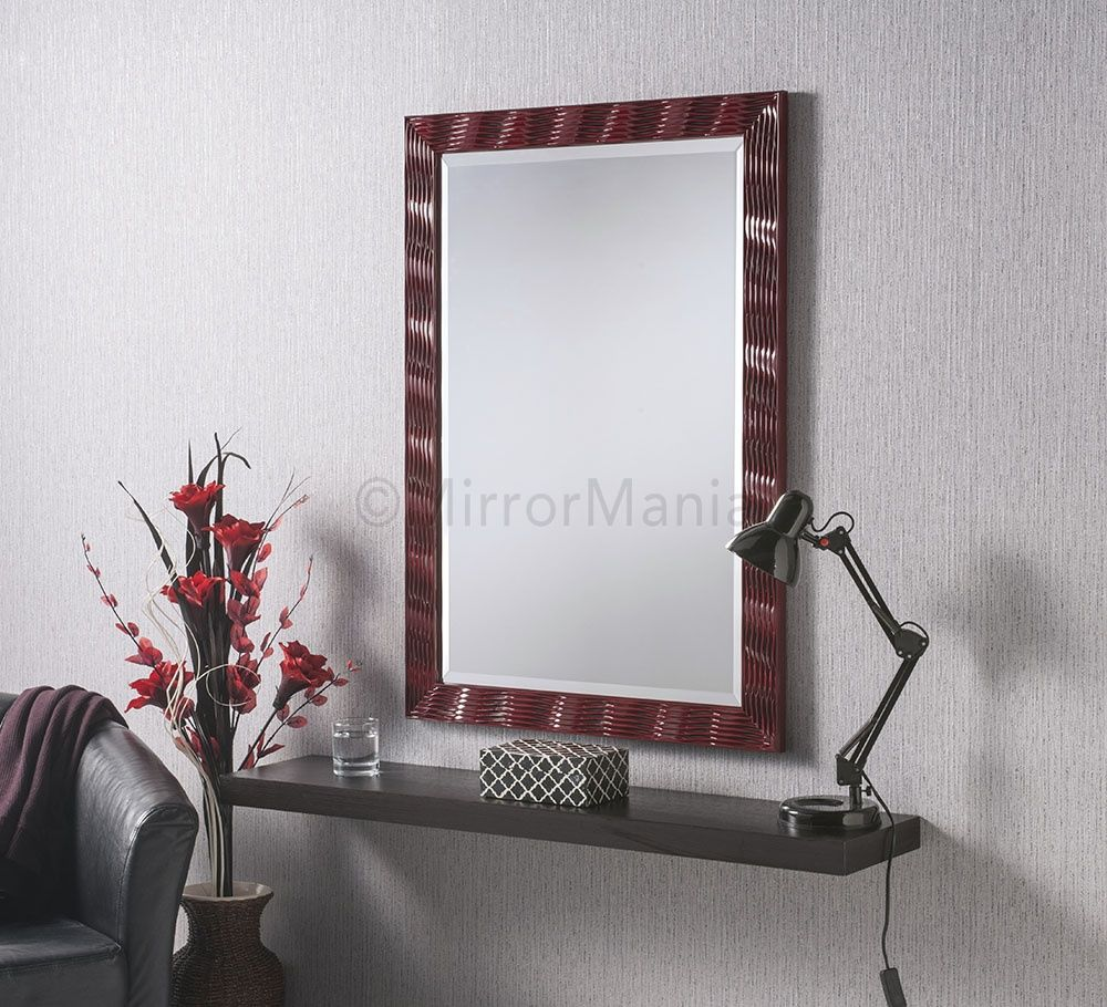 Alexei features a central bevelled #mirror, framed by a red, etched ...