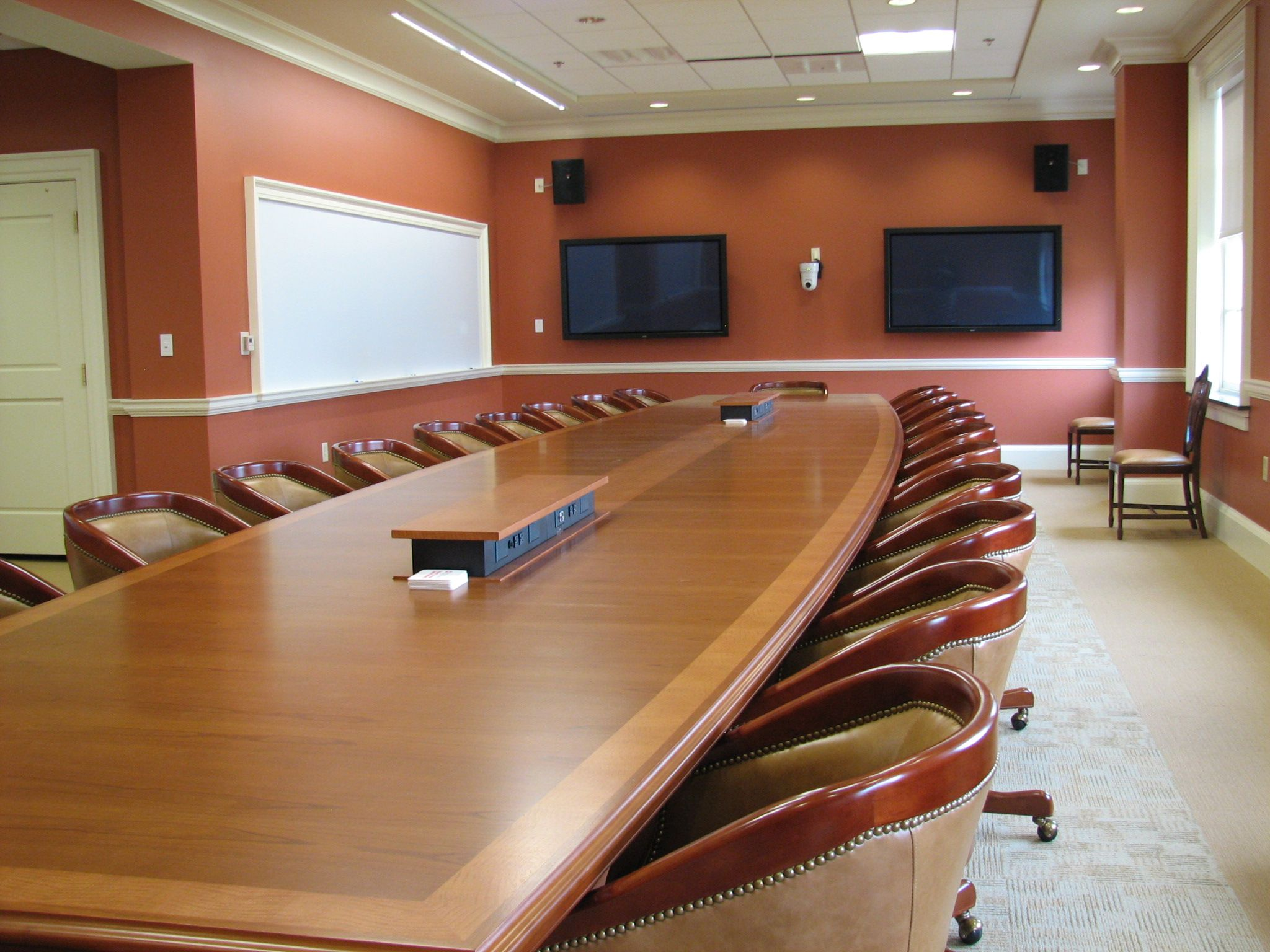 Boat shaped conference tables with integrated power and ...